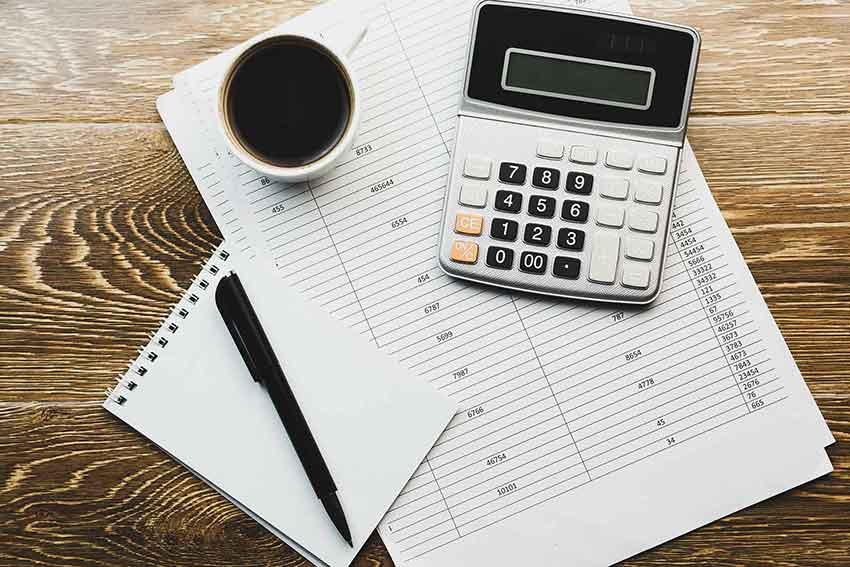 Office desk calculator and medical code sheet